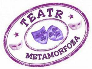 Logo teatru Metamorfoza, kształt owalny, napis fioletowy, na środku dwie maski teatralne